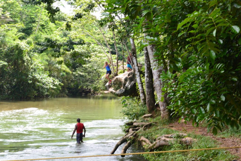 Belize cave tubing river rock jump