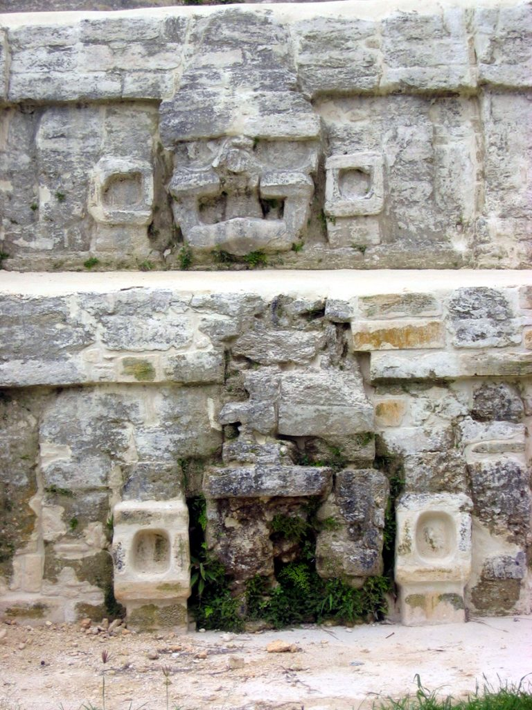 Stuccoed Jester God face altun ha belize